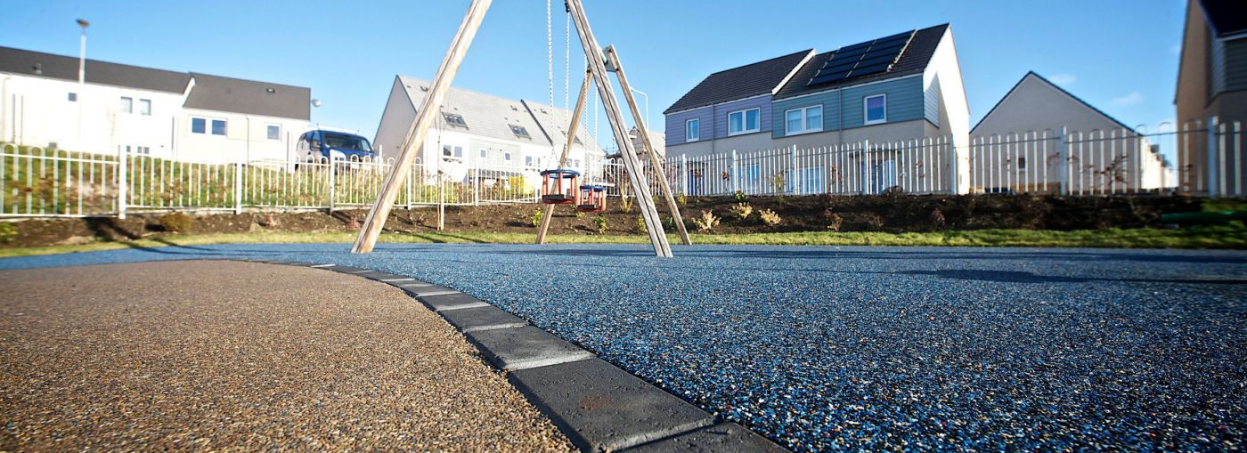Rubber playground flooring in a house estate.